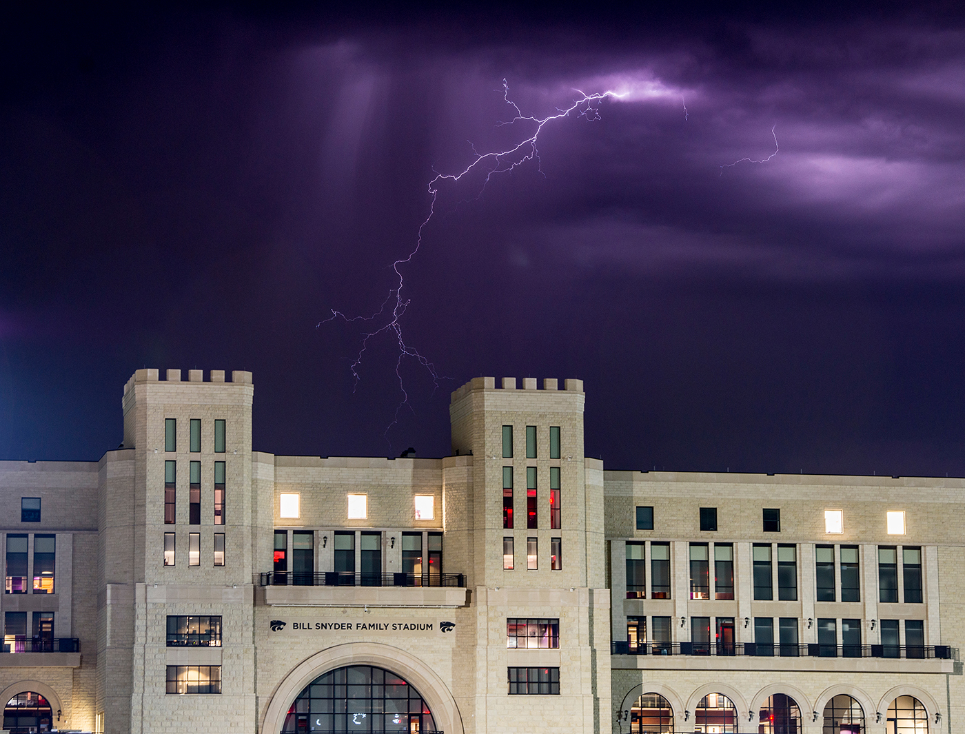 Lightning fills the sky behind the West Stadium Center of Bill Snyder Family Stadium early May 3, 2015.