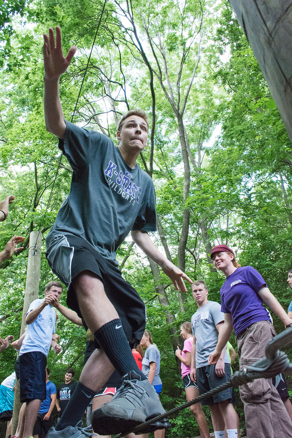 Incoming freshman Alex Westrope balances on a wire at the K-State Challenge Course during Wildcat Warmup. The K-State Challenge Course offers team-building activities to groups and is especially helpful to college freshman.
