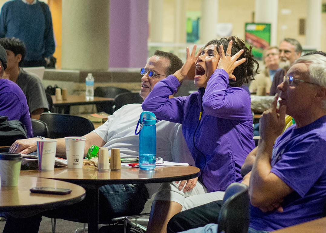 Alicia Egan, senior in modern languages, reacts to a missed pass during the football game against Auburn on Sept. 18, 2014. Many students gathered in the K-State Student Union to watch the game on the big screen.