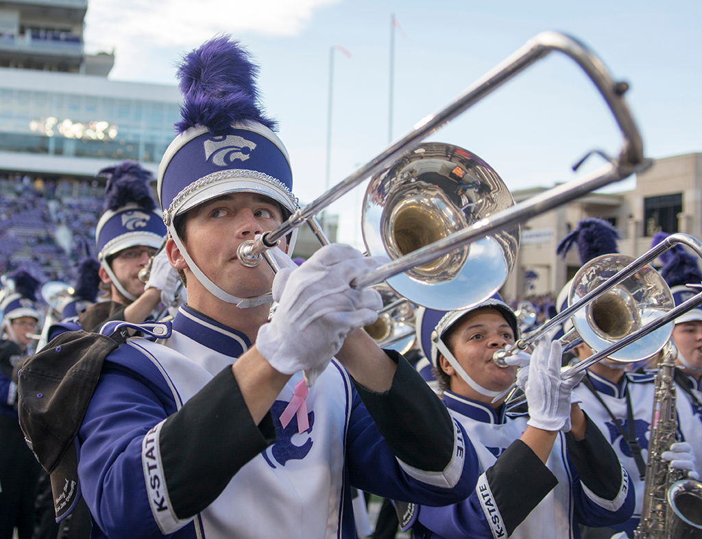 A K-State band member plays a trombone during the game against Texas Tech on Oct. 4, 2014.