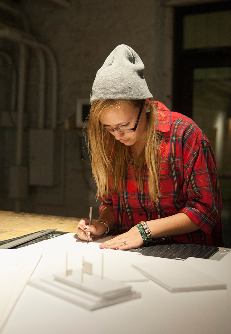 Kaylee McIlvaine, freshman in environmental design, cuts foamboard for a simple space model in Seaton Hall on Oct. 6, 2014.