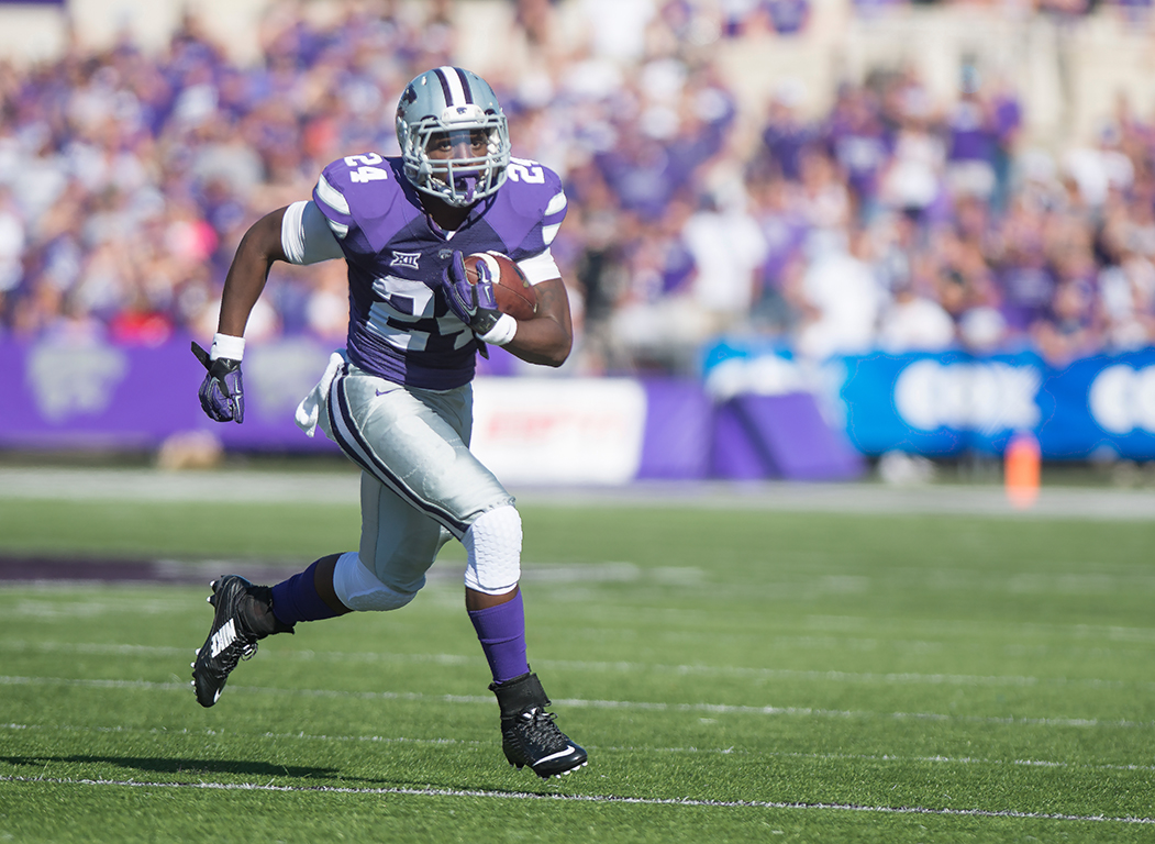 K-State running back Charles Jones takes the ball downfield during the game against Texas on Oct. 25, 2014 in Bill Snyder Family Stadium.